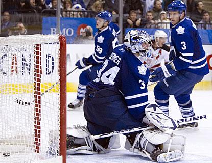 Toronto's defense and goalie James Reimer react too late on Ilya Kovalchuk's (background) shot for the deciding goal. (AP)