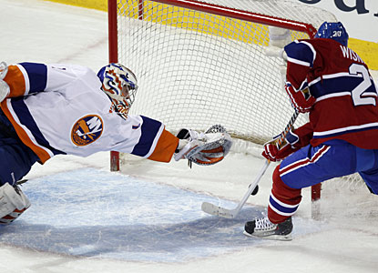 Mikko Koskinen makes a superb diving save on what looks like a sure goal by James Wisniewski. (AP)