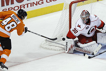 Danny Briere goes top shelf on goalie Cam Ward's short-side for what turns out to be the winning goal. (AP)
