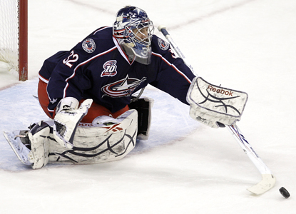Mathieu Garon makes one of his 31 saves in his first start in over two weeks as the Blue Jackets beat the Avalanche. (AP)