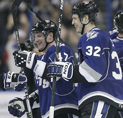 The Lightning's Marc-Andre Bergeron (47) receives plenty of love from teammates after he scores the game winner in OT.  (AP)