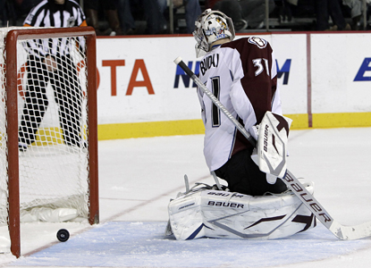 Avalanche goalie Peter Budaj watches as Predators defenseman Cody Franson's shot rolls in for a third-period goal. (AP)