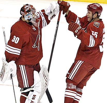 Coyotes goalie Ilya Bryzgalov celebrates with teammate Ed Jovanovski after blanking the Blackhawks in a shootout.  (AP)