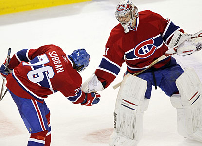 P.K. Subban celebrates the victory with Carey Price, who earns his sixth shutout this season. (AP)