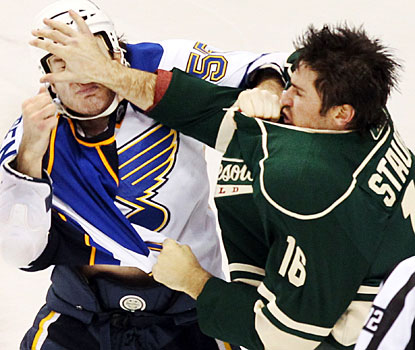 Wild's Brad Staubitz gives Cam Jansen a facial massage in one of three fights in the game between the teams. (AP)