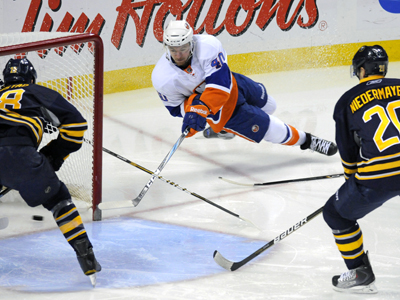 The Islanders' Michael Grabner scores his first of three goals on this tricky wrap-around shot.  (Getty Images)