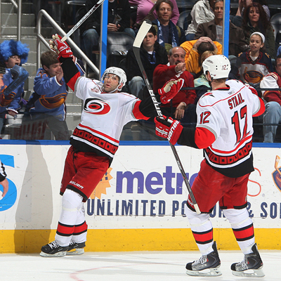 Erik Cole (left) throws his hands up in celebration after scoring the go-ahead goal with 1:19 left in the third.  (Getty Images)