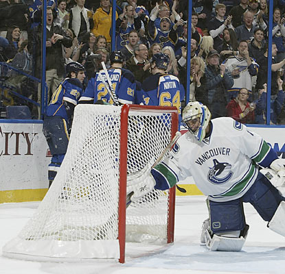 Alexander Steen (left) and the Blues celebrate after Steen scores a goal against the Canucks' Roberto Luongo. (Getty Images)