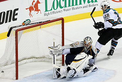 Patrick Marleau puts the puck past Pekka Rinne in overtime after escaping on a breakaway. (AP)
