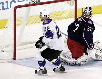 Jarret Stoll slots the puck past goalie Mathieu Garon for the only goal scored in the shootout. (AP)