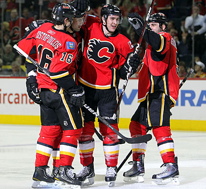 Defenseman Cory Sarich (center), who doesn't score too often, enjoys his third goal of the season. (Getty Images)
