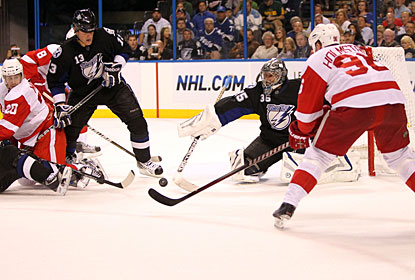 Tomas Holmstrom passes the puck through traffic to find Justin Abdelkader (8), who scores a goal for Detroit. (US Presswire)