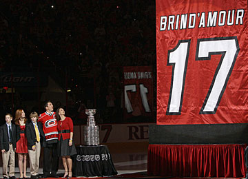 Rod Brind'Amour and family watch as his No. 17 is retired and raised to the rafters. (AP)