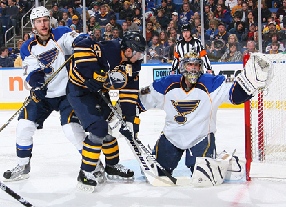 Blues goalie Ty Conklin makes a save in front of Jochen Hecht of the Sabres en route to a 25-save shutout. (Getty Images)