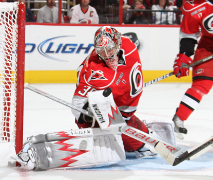 Hurricanes goalie Cam Ward makes several spectacular stops to finish the night with 21 saves. (Getty Images)