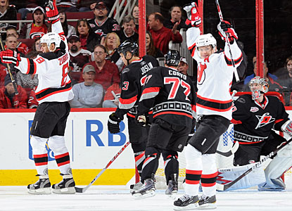 Dainius Zubrus (left) opens with a goal 1:14 into the game, then finishes New Jersey's scoring with a wrister in the third. (Getty Images)
