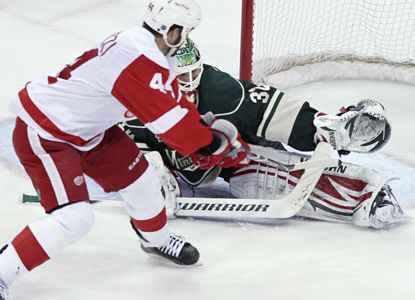 Todd Bertuzzi scores a shootout goal on Wild goalie Niklas Backstrom to give the Red Wings the win  (AP)