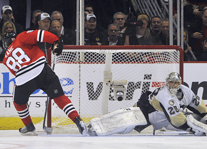 Patrick Kane fools Penguins goalie Marc-Andre Fleury and scores a shootout goal that gives the Blackhawks the win. (AP)