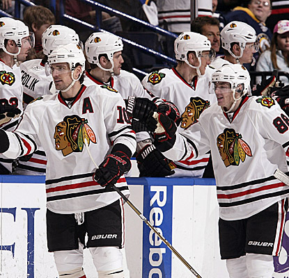 Patrick Sharp and Patrick Kane are congratulated after Kane scores the go-ahead goal in the second period.  (Getty Images)