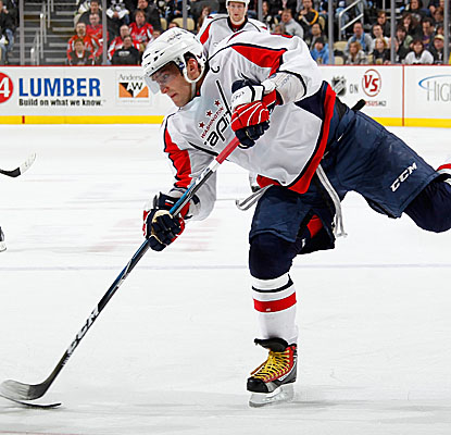 Washington's Alex Ovechkin takes a shot against Penguins defenders, scoring the game's only goal.  (Getty Images)