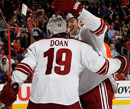 Shane Doan is congratulated by Lauri Korpikoski after Doan notches the winner in overtime. (Getty Images)