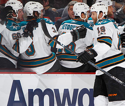 Joe Thornton (19) gets his props from teammates after reaching the 300-goal plateau for his career. (Getty Images)