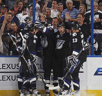 Teddy Purcell (second from right) is congratulated by teammates for his first career three-goal game. (Getty Images)