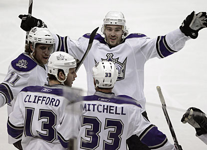 Kings players congratulate Willie Mitchell, who breaks a 2-2 tie with his first goal since October 28. (AP)