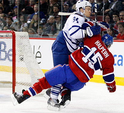 There's no love between Toronto and Montreal as Mikhail Grabovski takes down Jeff Halpern with hard body check. (Getty Images)