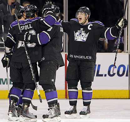Captain Dustin Brown joins the celebration after Jarrett Stoll scores what proves to be the winning goal. (AP)