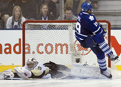 Pittsburgh's Marc-Andre Fleury makes a save in the shootout as Joffrey Lupul loses his balance. (AP)