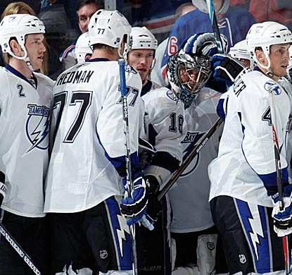 Lightning teammates congratulate Dwayne Roloson after limiting the Rangers to one goal in 23 shots.  (Getty Images)