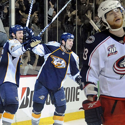 Nashville's Shea Weber (left) and David Legwand celebrate Legwand's game-winning goal. (AP)