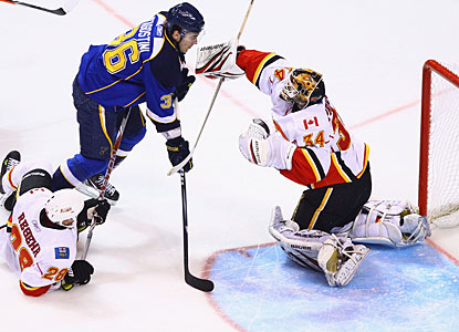 After stopping 27 shots Sunday in Calgary, Miikka Kiprusoff stops 25 in St. Louis to shut out the Blues in back-to-back games. (Getty Images)
