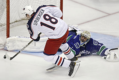 Roberto Luongo stretches to the max to keep R.J. Umberger from scoring in the shootout. (AP)