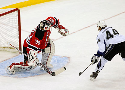 Martin Brodeur denies Nate Thompson a one-on-one chance, making one of his 15 saves on the night. (Getty Images)