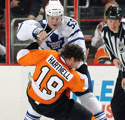 Kevin Aullie takes down Scottie Hartnell much like the Leafs do to the Flyers in Philadelphia.  (Getty Images)