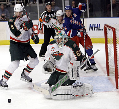 Jose Theodore stops 40 shots and continues to get the best of the Rangers, improving to 13-3-2 in 18 starts against New York. (AP)