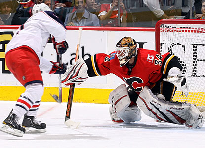 Calgary's Miikka Kiprusoff stops Matt Calvert on a penalty shot in the second period. (Getty Images)