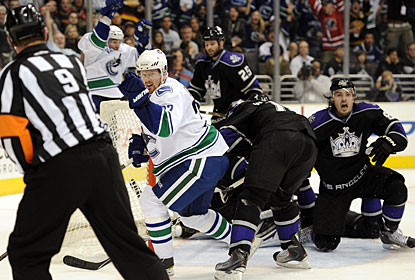 League-leading scorer Daniel Sedin jumps on a rebound in front to collect his 33rd goal. (Getty Images)