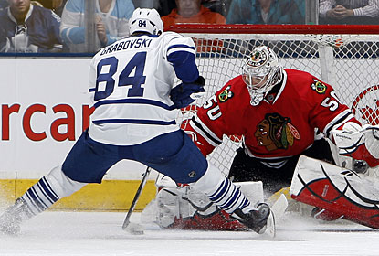 Mikhail Grabovski tries a move on Blackhawks goalie Corey Crawford on this penalty shot, but comes up with no goal.  (Getty Images)