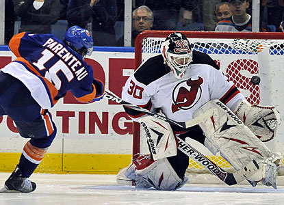 Martin Brodeur blocks a shot by the Islanders' P.A. Parenteau during the Devils' 3-2 shootout win. (AP)