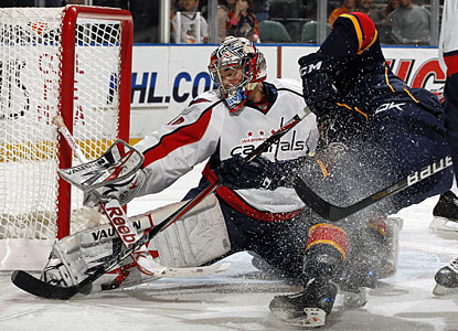 Washington's Michal Neuvirth stops a shot by Florida's Michal Repik, one of his 32 saves.  (Getty Images)