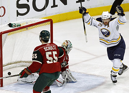 Buffalo's Jason Pominville celebrates after he scores on Minnesota goalie Jose Theodore for a 1-0 lead. (AP)