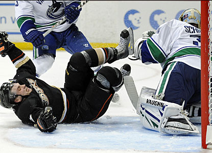 Cory Schneider stops everything from entering Vancouver's goal, including Anaheim's Bobby Ryan. (AP)