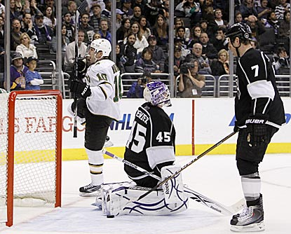 Brenden Morrow celebrates while Kings goaltender Jonathan Bernier and defenseman Rob Scuderi sag after Morrow scores in OT.  (AP)