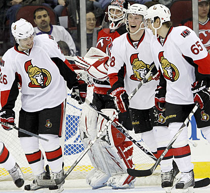 Erik Condra (middle), playing in his 10th NHL game, scores both goals for Ottawa after also scoring two against the Flyers. (AP)