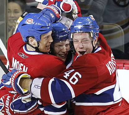 Lars Eller (center) celebrates his second goal of the game with Travis Moen and Andrei Kostitsyn. (AP)