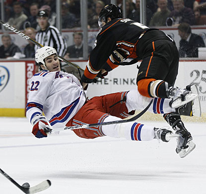 Luca Sbisa, who Tuesday signed a four-year contract extension with Anaheim, delivers a body check to Brian Boyle. (AP)