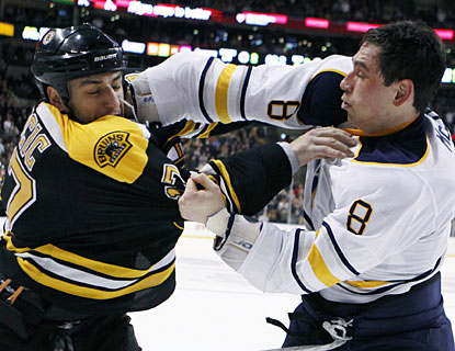 Buffalo's Cody McCormick (8) fights Boston's Milan Lucic after also having a bout with Gregory Campbell earlier. (AP)